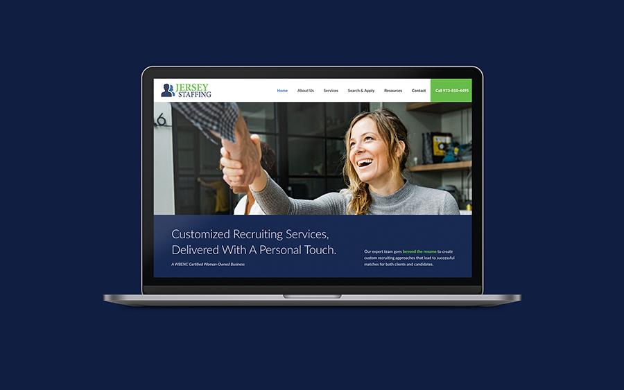 Macbook with website design on screen