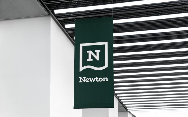 Newton branding logo design on a banner