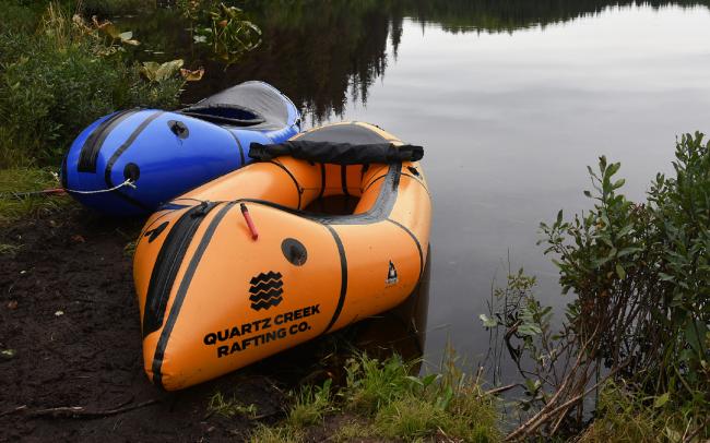 White water raft with Quartz Creek logo printed on it